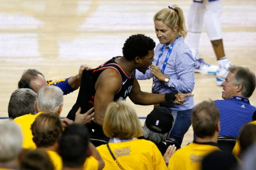 OAKLAND, CALIFORNIA - JUNE 05:  Kyle Lowry #7 of the Toronto Raptors argues with Warriors minority investor Mark Stevens (blue shirt) after Lowry chased down a loose ball in the second half against the Golden State Warriors during Game Three of the 2019 NBA Finals at ORACLE Arena on June 05, 2019 in Oakland, California. According to to the Warriors, Stevens will not be in attendance for the remainder of the NBA Finals as they look further into the incident. NOTE TO USER: User expressly acknowledges and agrees that, by downloading and or using this photograph, User is consenting to the terms and conditions of the Getty Images License Agreement. (Photo by Lachlan Cunningham/Getty Images)