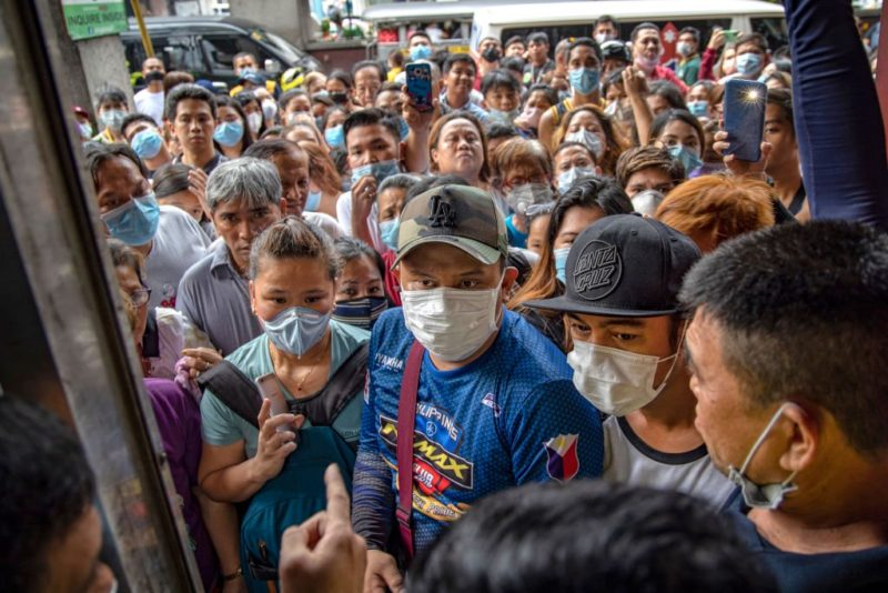 MANILA, PHILIPPINES - JANUARY 31: Filipinos hoping to buy face masks crowd outside a medical supply shop that was raided by police for allegedly hoarding and overpricing the masks, as public fear over China's Wuhan Coronavirus grows, on January 31, 2020 in Manila, Philippines. The Philippine government has been heavily criticized after failing to immediately implement travel restrictions from China, the source of a deadly coronavirus that has now killed hundreds and infected thousands more. The World Health Organization (WHO) on Thursday declared the coronavirus a public health emergency of international concern. (Photo by Ezra Acayan/Getty Images)