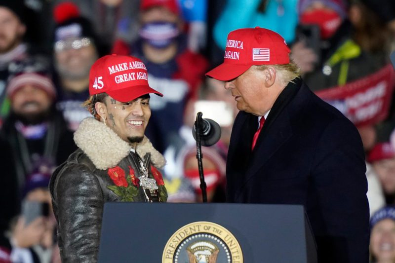 President Donald Trump brings rapper Lil Pump to the podium during a campaign event early Tuesday, Nov. 3, 2020, in Grand Rapids, Mich. (AP Photo/Carlos Osorio)
