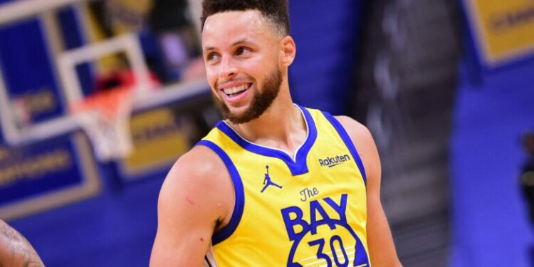 SAN FRANCISCO, CA - APRIL 6: Stephen Curry #30 of the Golden State Warriors smiles and walks off the court against the Milwaukee Bucks on April 6, 2021 at Chase Center in San Francisco, California. NOTE TO USER: User expressly acknowledges and agrees that, by downloading and or using this photograph, user is consenting to the terms and conditions of Getty Images License Agreement. Mandatory Copyright Notice: Copyright 2021 NBAE (Photo by Noah Graham/NBAE via Getty Images)