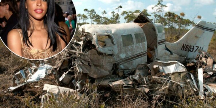 The plane, in which singer and actress Aaliyah died, rests in a swamp area on the western end of the Marsh Harbour International Airport runway Sunday Aug. 26, 2001. All nine people on board perished in the crash. (AP Photo/Tim Aylen)